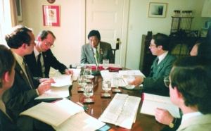 Vidyadhara Chogyam Trungpa Rinpoche meeting with the Translation Committee at the Kalapa Court in Boulder (1985). Photo by Liza Matthews.