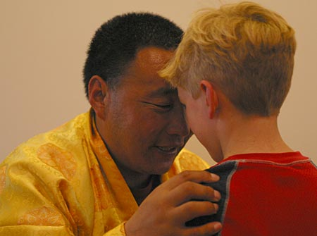 Karma Senge Rinpoche and Finlay Miller meet eye-to-eye. Photo by Marvin Moore.